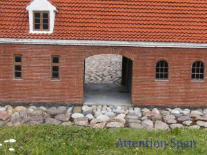 Brick courtyard entrance in miniature village