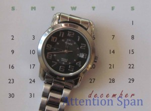 Timex analog watch on calendar backdrop