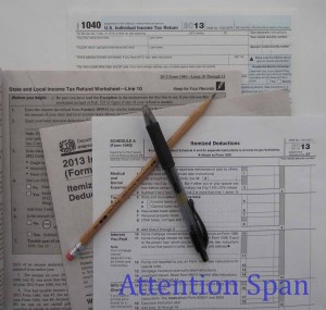 arrangement of 2013 tax forms under crossed pen and pencil