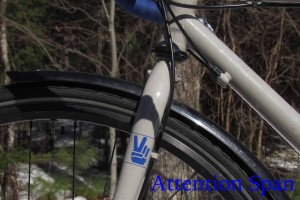part of front bike wheel with Peace sign on fork