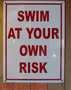warning sign in pool area