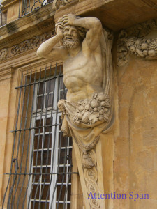 statue on building with expression of pain